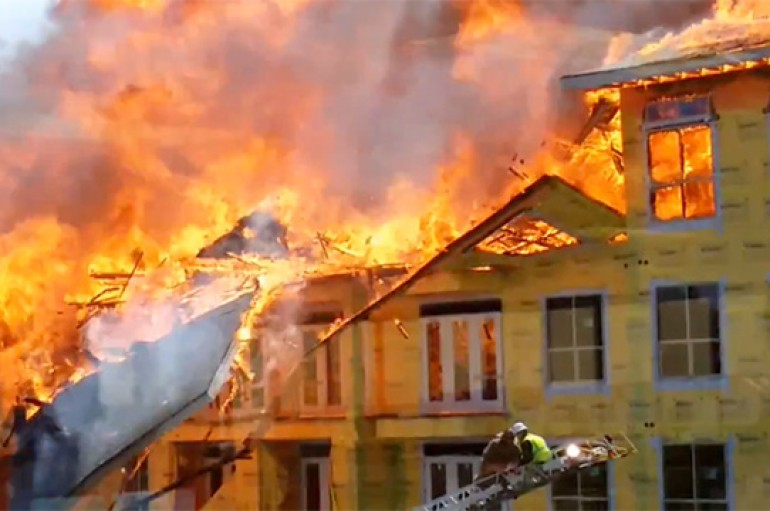 Firefighter Saves Man From Blazing Building Right On Time
